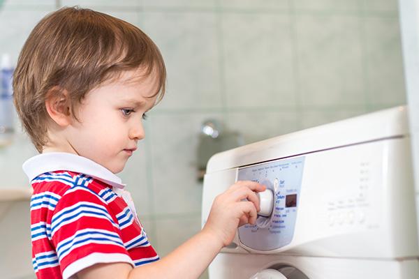 child doing laundry